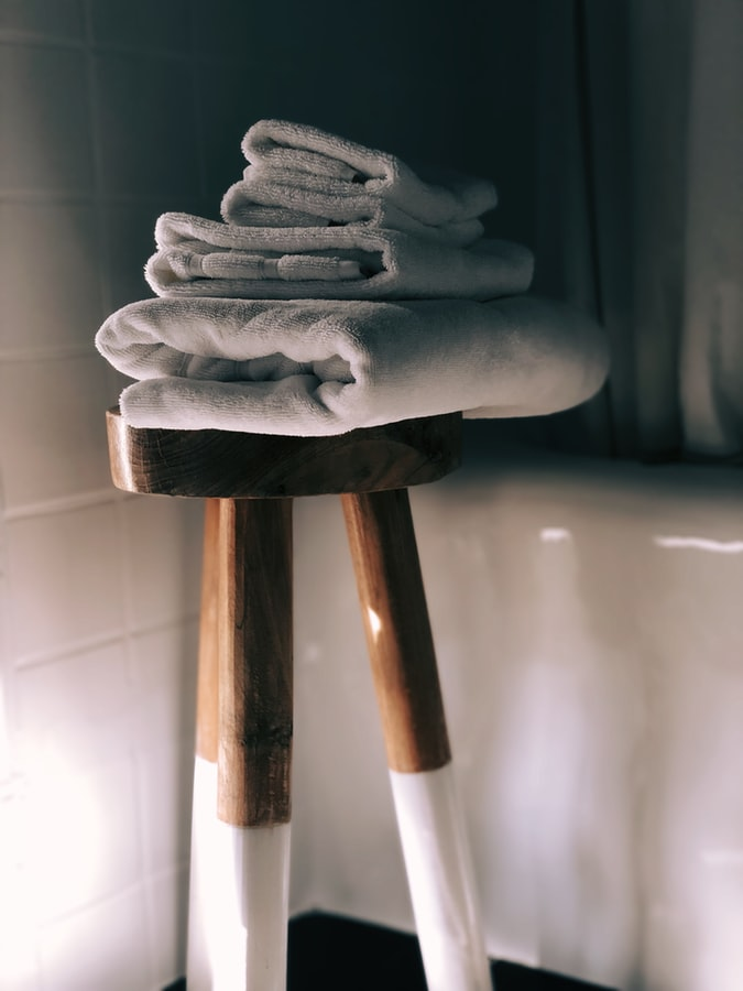 Slide a stool next to the bathtub to give a luxe look​