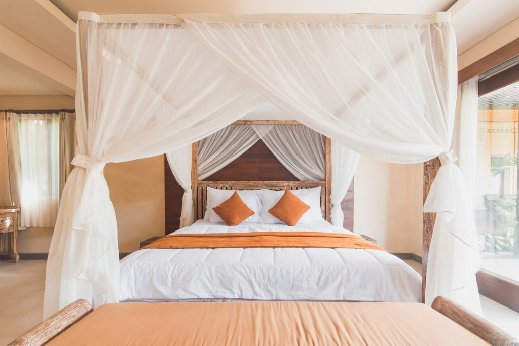 Etherealize bedroom using a bed canopy​